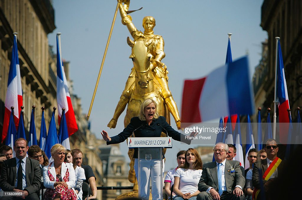 France's far-right National Front President, <a gi-track='captionPersonalityLinkClicked' href=/galleries/search?phrase=Marine+Le+Pen&family=editorial&specificpeople=588282 ng-click='$event.stopPropagation()'>Marine Le Pen</a> delivers a speech during the party's annual celebration of Joan of Arc on May 1, 2011 in Paris, France. France's far-right National Front members took part in its traditional Joan of arc May Day Rally with the party's new leader, as thousands across the globe took to the streets to rally for worker's rights on International Workers' Day.