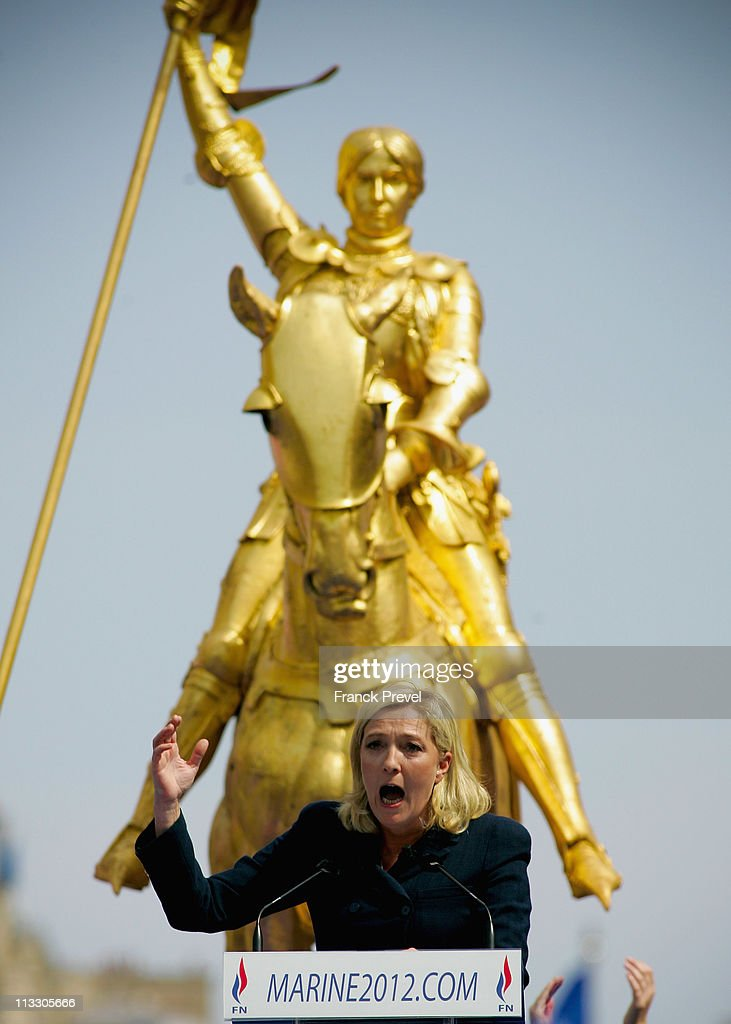 France's far-right National Front President, Marine Le Pen delivers a speech during the party's annual celebration of Joan of Arc on May 1, 2011 in Paris, France. France's far-right National Front members took part in its traditional Joan of arc May Day Rally with the party's new leader, as thousands across the globe took to the streets to rally for worker's rights on International Workers' Day.