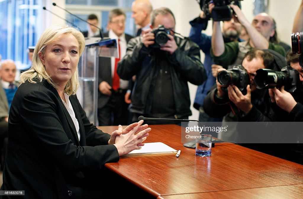 France's Farright Party Front National President Marine Le Pen delivers a speech during a press conference on January 16 2015 in Nanterre France...