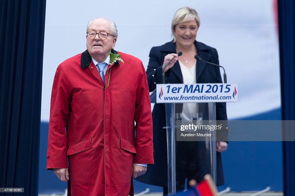 France's far-right political party Front National (FN) founder and honorary president, <a gi-track='captionPersonalityLinkClicked' href=/galleries/search?phrase=Jean-Marie+Le+Pen&family=editorial&specificpeople=214017 ng-click='$event.stopPropagation()'>Jean-Marie Le Pen</a> gestures on stage as FN's president <a gi-track='captionPersonalityLinkClicked' href=/galleries/search?phrase=Marine+Le+Pen&family=editorial&specificpeople=588282 ng-click='$event.stopPropagation()'>Marine Le Pen</a> looks on during the party's annual rally honoring Joan of Arc on Place de l'Opera, on May 1, 2015 in Paris, France. Annually over 1000 people from the FN Party demonstrate on May 1st.