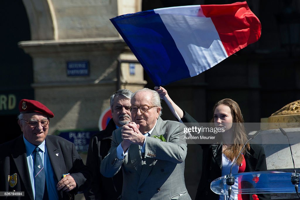 France's far-right Political Party Front National (FN) founder and honorary President, <a gi-track='captionPersonalityLinkClicked' href=/galleries/search?phrase=Jean-Marie+Le+Pen&family=editorial&specificpeople=214017 ng-click='$event.stopPropagation()'>Jean-Marie Le Pen</a> waves at the crowd on stage during the party's annual rally honoring Joan of Arc on May 1, 2016 in Paris, France. Annually over 1000 people from the FN Party demonstrate on May 1st.
