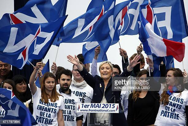 France's farright political party Front National president Marine Le Pen waves to supporters after delivering a speech on stage at the Opera place...