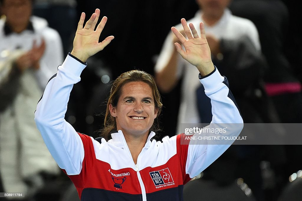 France's Fed Cup captain Amelie Mauresmo celebrates after her team won the Fed Cup World Group first round tennis match against Italy in Marseille, southern France, on February 7, 2016. / AFP / ANNE-CHRISTINE POUJOULAT