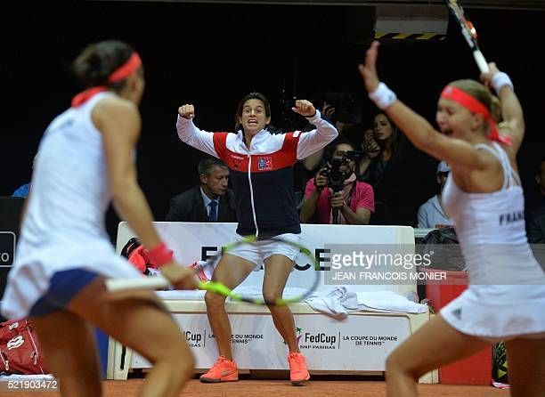 France's Fed Cup captain Amelie Mauresmo celebrates as France's Kristina Mladenovic and Caroline Garcia win the Fed Cup semifinal double tennis match...