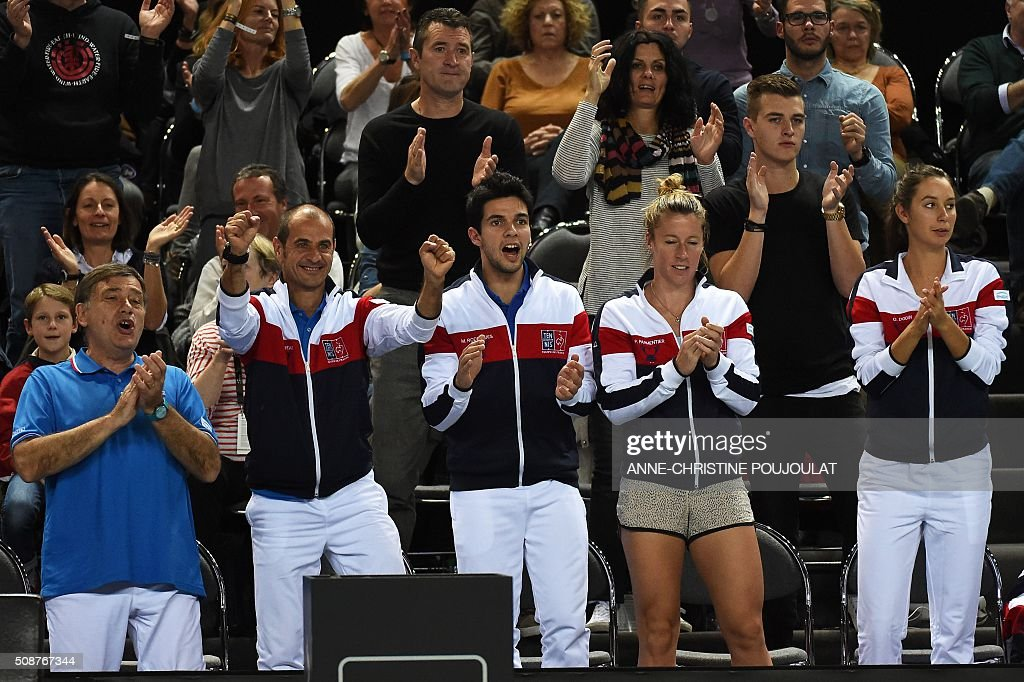France's Fed Cup team reacts during the match between Italy's Fed Cup Sara Errani and France's Caroline Garci during the first round of the Tennis Fed Cup World Group between France an Italy on February 6, 2016 in in Marseille, southern France. / AFP / ANNE-CHRISTINE POUJOULAT