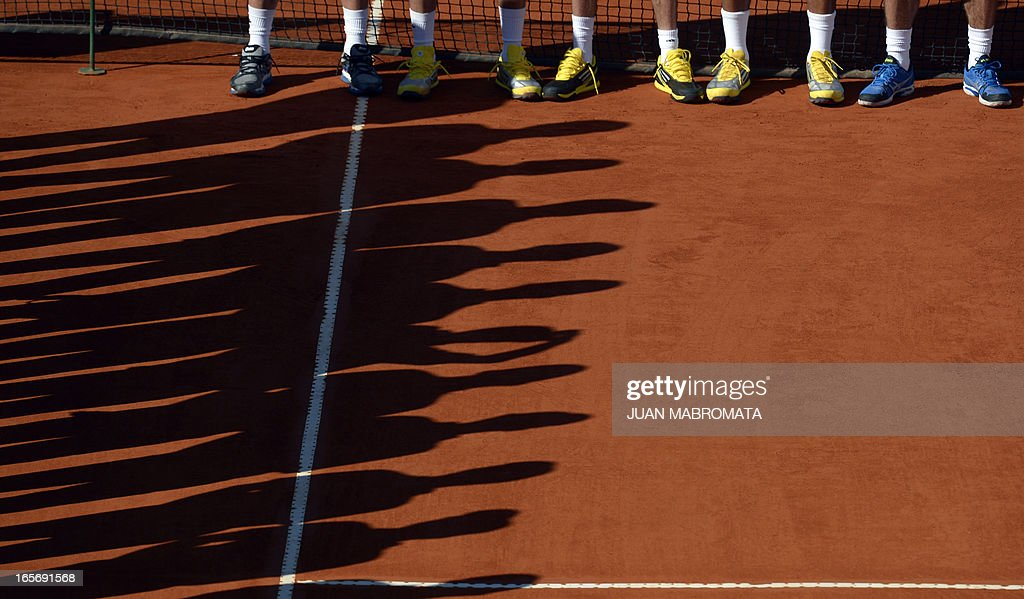 France's feet and judges shadows during the Davis Cup quarterfinals tennis oppening ceremony France vs Argentina at Mary Teran de Weiss stadium in Roca Park on April 5, 2013, in Buenos Aires, Argentina.