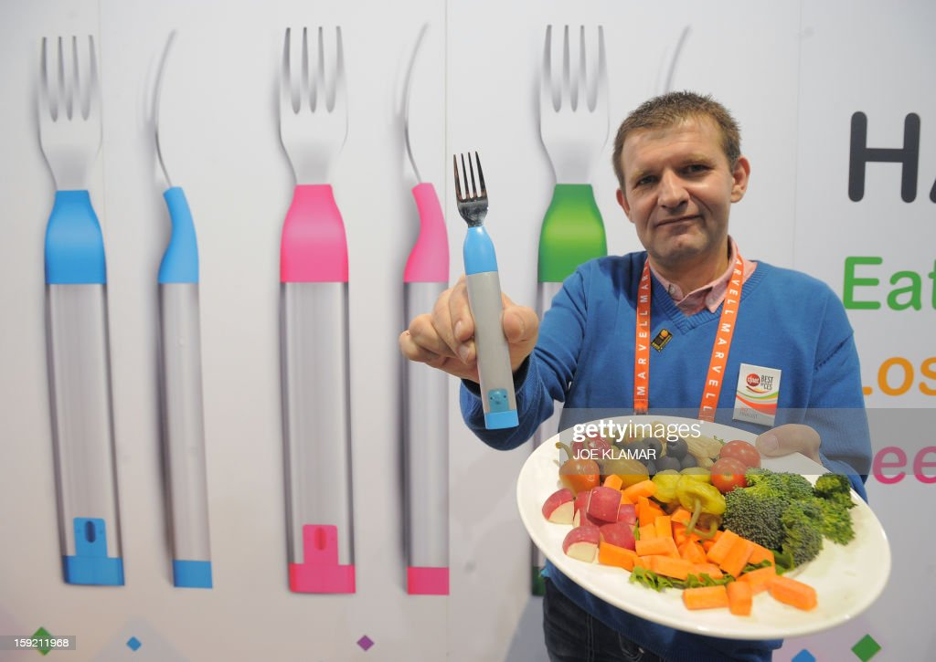 France's Filippe Monteiro Da Rocha of Hapilabs displays wireless computer connected forks ,controlling appetite and collecting dining informations ,at the 2013 International CES at the Las Vegas Convention Center on January 9, 2013 in Las Vegas, Nevada. CES, the world's largest annual consumer technology trade show, runs from January 8-11 and is expected to feature 3,100 exhibitors showing off their latest products and services to about 150,000 attendees.