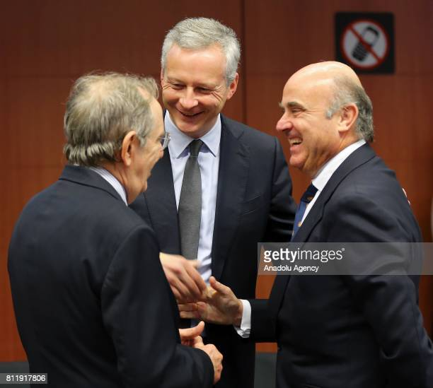 France's Finance Minister Bruno Le Maire Italy's Finance Minister Pier Carlo Padoan and Spain's Finance Minister Luis de Guindos attend the Eurogroup...