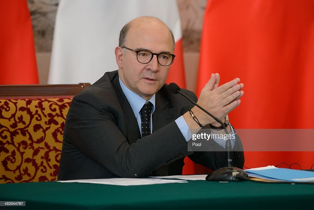 France's Finance Minister <a gi-track='captionPersonalityLinkClicked' href=/galleries/search?phrase=Pierre+Moscovici&family=editorial&specificpeople=667029 ng-click='$event.stopPropagation()'>Pierre Moscovici</a> speaks during a joint press conference with China's Vice Premier Ma Kai following a signing ceremony at a France-China High-Level Economic and Financial Dialogue meeting at the Diaoyutai State Guesthouse on November 26, 2013 in Beijing, China.