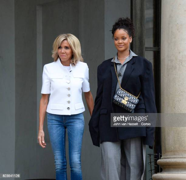 France's First Lady Brigitte Macron receives singer and songwriter Rihanna at the Elysée Palace on July 26 2017 in Paris Main issue of the visit...