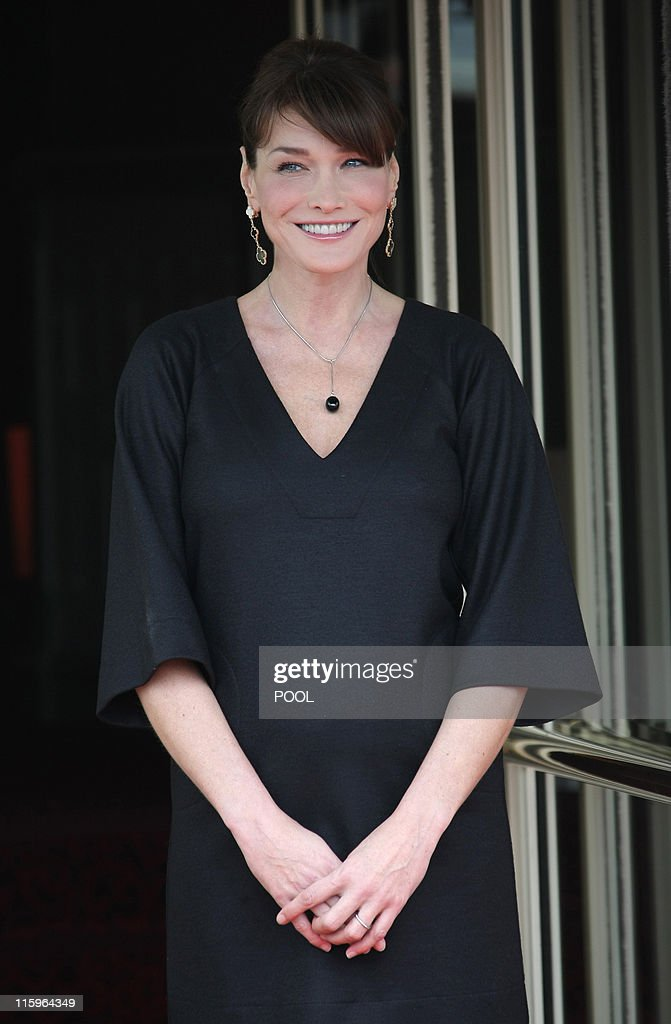 France's First Lady <a gi-track='captionPersonalityLinkClicked' href=/galleries/search?phrase=Carla+Bruni&family=editorial&specificpeople=235729 ng-click='$event.stopPropagation()'>Carla Bruni</a>-Sarkozy waits for the arrival of the wives of the Heads of Delegation of African countries and international organizations participating in the outreach session at the G8 summit in Deauville, on May 27, 2011. G8 leaders sought Friday to thrash out a common position on how to support Arab democratic revolts, brandishing a threat of action against Syria and demanding Libyan leader Moamer Kadhafi go.