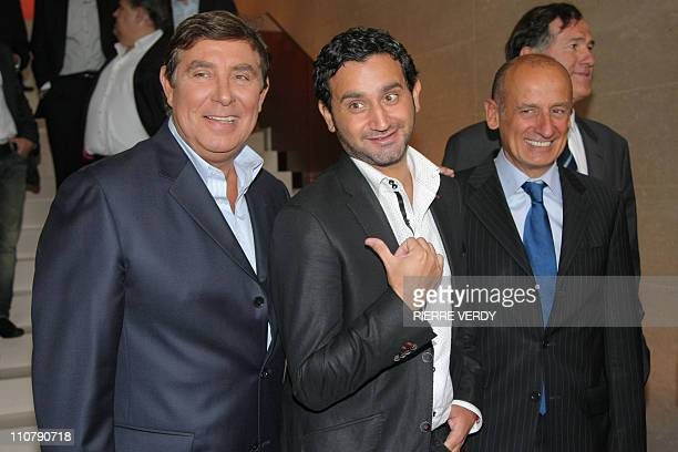 France's first radio station RTL hosts From L JeanPierre Foucault Cyril Hanouna and JeanMichel Apathie pose before a press conference announcing the...
