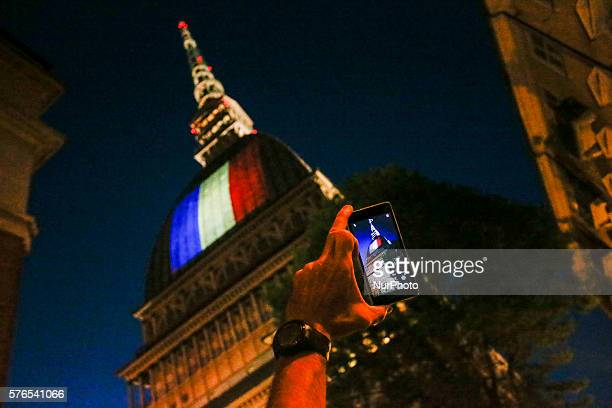 France's flag illuminates the Mole Antonelliana in Turin on July 15 2016 after the deadly attacks in Nice Three days of national mourning begins in...