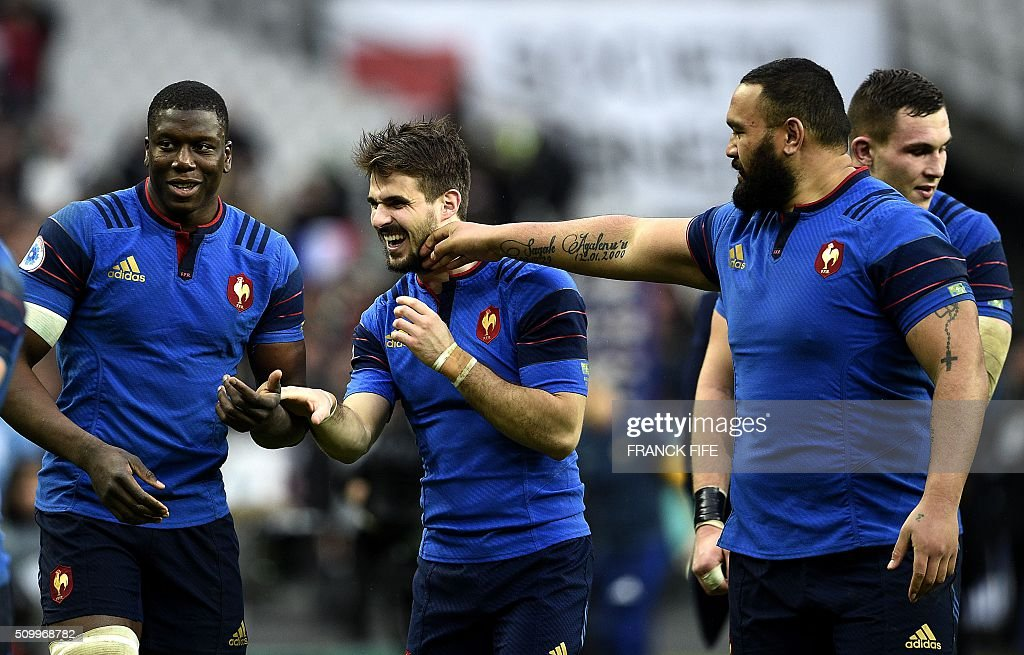 Frances flancker Yacouba Camara, France's right wing Hugo Bonneval and Frances tight head prop Uini Atonio celebrate after France defeated Ireland 10-9 in their Six Nations international rugby union match on February 13, 2016 at the Stade de France in Saint-Denis, north of Paris. AFP PHOTO / FRANCK FIFE / AFP / FRANCK FIFE