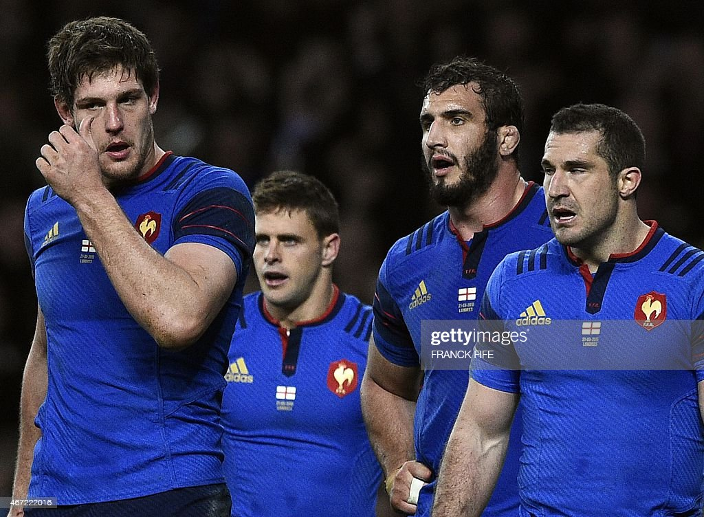 France's flanker Alexandre Flanquart, France's scrum half <a gi-track='captionPersonalityLinkClicked' href=/galleries/search?phrase=Rory+Kockott&family=editorial&specificpeople=4145424 ng-click='$event.stopPropagation()'>Rory Kockott</a>, France's lock <a gi-track='captionPersonalityLinkClicked' href=/galleries/search?phrase=Yoann+Maestri&family=editorial&specificpeople=6704761 ng-click='$event.stopPropagation()'>Yoann Maestri</a> and France's full back <a gi-track='captionPersonalityLinkClicked' href=/galleries/search?phrase=Scott+Spedding&family=editorial&specificpeople=561874 ng-click='$event.stopPropagation()'>Scott Spedding</a> react during the Six Nations international rugby union match between England and France at Twickenham Stadium, south west of London on March 21, 2015. England won the game 55-35 but the Six Nations title went to Ireland on points difference. AFP PHOTO / FRANCK FIFE