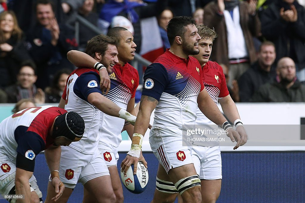 France's flanker Damien Chouly (2nd R) celebrates with teammates after scoring a try during the Six Nations international rugby union match between France and Italy at the Stade de France in Saint-Denis, north of Paris, on February 6, 2016. AFP PHOTO / THOMAS SAMSON / AFP / THOMAS SAMSON