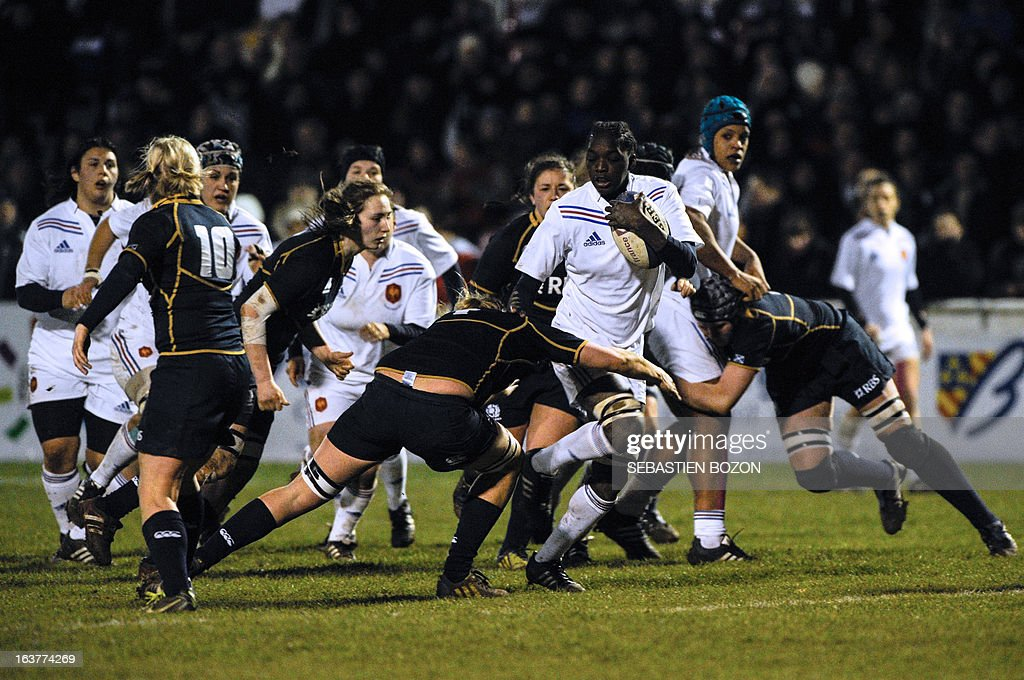 France's Flanker Diallo Cumba (3rdR) runs with the ball during the Six Nations women's international rugby union match between France and Scotland at the Bourillot Stadium in Longvic, eastern France, on March 15, 2013.