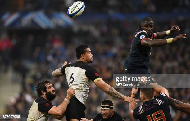 France's flanker Judicaël Cancoriet leaps in the lineout with New Zealand's flanker Vaea Fifita during the friendly rugby union international Test...