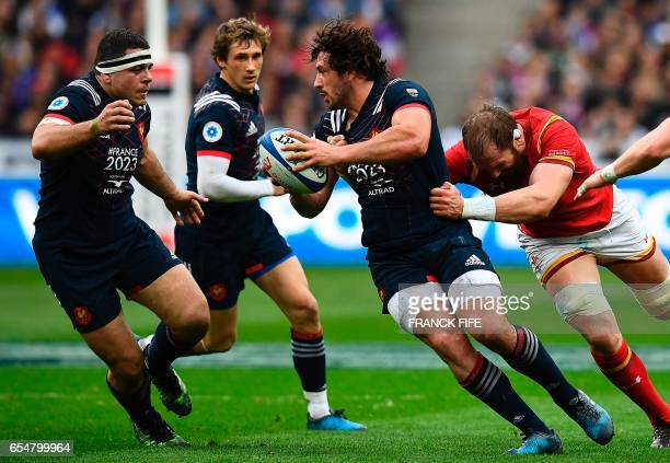 France's flanker Kevin Gourdon passes a ball to Frances hooker and captain Guilhem Guirado during the Six Nations tournament Rugby Union match...