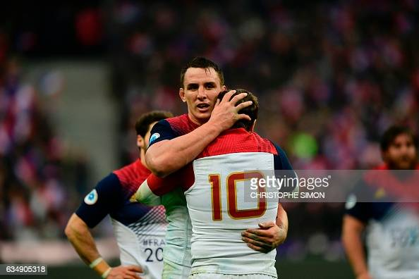 TOPSHOT France's flanker Louis Picamoles celebrates with his teammate France's fly half Camile Lopez after winning the Six Nations international...