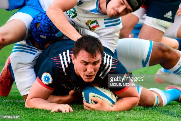 France's flanker Louis Picamoles scores a try during the International Six Nations rugby union match Italy vs France on March 11 2017 at the Olympic...