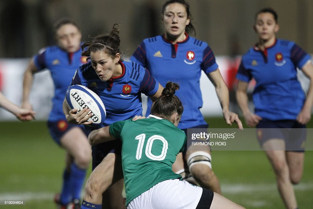 France's flanker Pauline Rayssac (L) is tackled by Ireland's fly-half Nikki Caughey during the Women's Six Nations rugby union match France vs Ireland, on February 13, 2016 in Perpignan. / AFP / RAYMOND ROIG