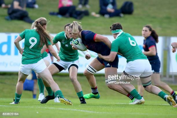 France's flanker Romane Menager bursts through the Irish defence to score the first try during the Women's Rugby World Cup 2017 pool C rugby match...