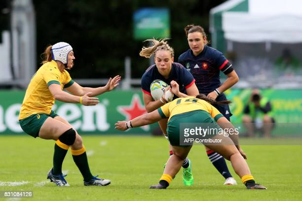 France's flanker Romane Menager is tackled by Australia's wing Nareta Marsters during the Women's Rugby World Cup 2017 pool C rugby match between...