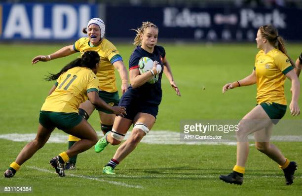 France's flanker Romane Menager runs in another try during the Women's Rugby World Cup 2017 pool C rugby match between France and Australia at The...