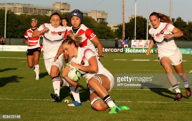 France's flanker Romane Menager scores the opening try during the Women's Rugby World Cup 2017 pool C rugby match between France and Japan at...