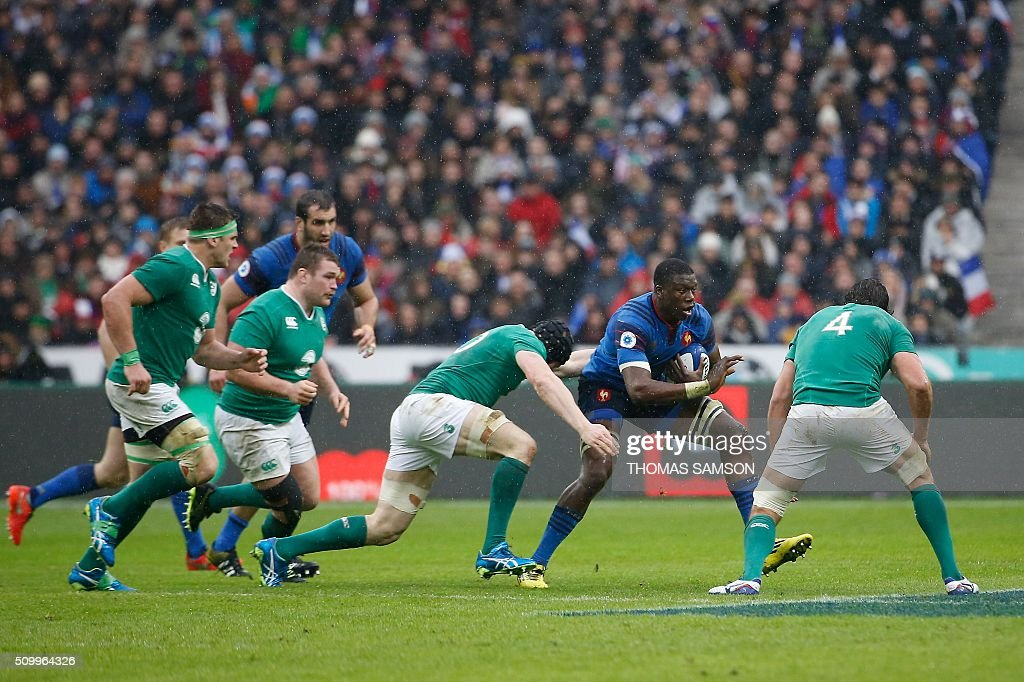France's flanker Yacouba Camara (2nd R) eavdes a tackle during the Six Nations international rugby union match between France and Ireland at the Stade de France Stadium in Saint-Denis, north of Paris, on February 13, 2016. AFP PHOTO / THOMAS SAMSON / AFP / THOMAS SAMSON