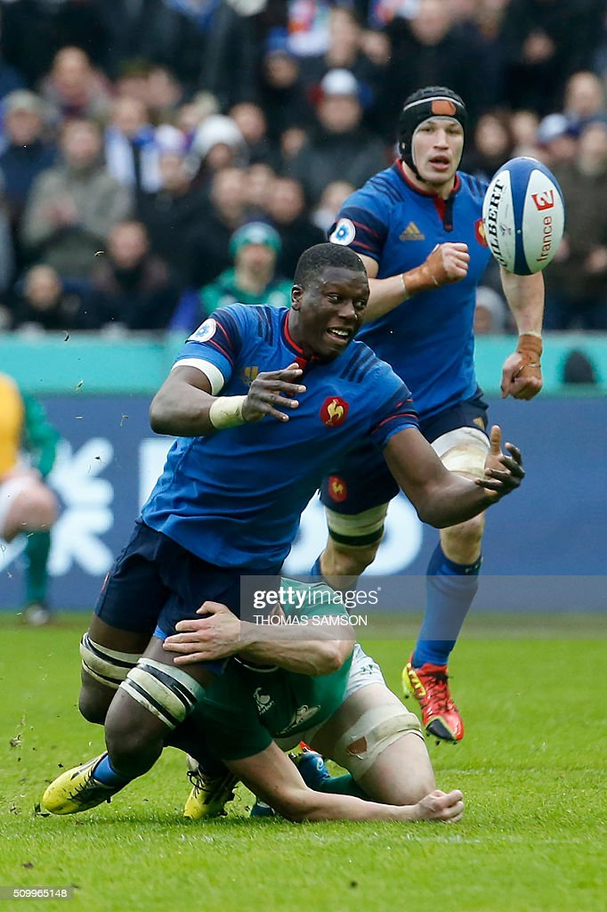 France's flanker Yacouba Camara is tackled during the Six Nations international rugby union match between France and Ireland at the Stade de France Stadium in Saint-Denis, north of Paris, on February 13, 2016. AFP PHOTO / THOMAS SAMSON / AFP / THOMAS SAMSON