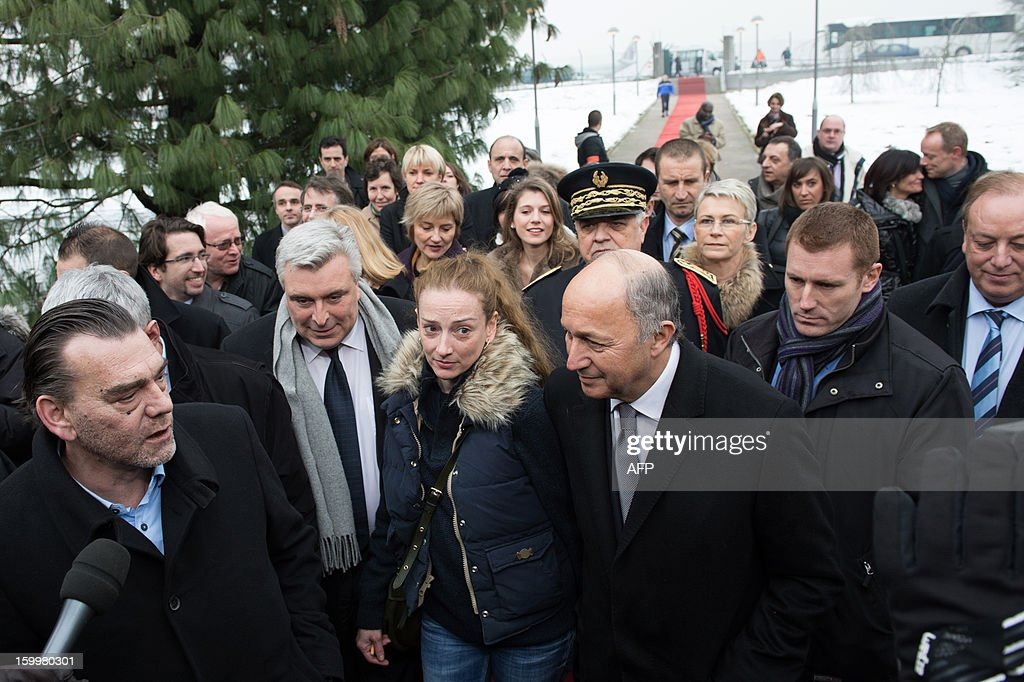 France's Florence Cassez, flanked by French Foreign minister Laurent Fabius (R) and her lawyer Frank Berton, arrives for a press conference at Roissy airport on January 24, 2013 in Roissy-en-France where she landed after being freed from a Mexican prison the day before following a Supreme Court ruling that police violated her rights by staging her arrest for kidnapping on national television seven years ago. After facing 60 years in jail, Cassez, 38, took a flight to Paris, hours after three of five justices voted for her immediate release in a case that had strained Franco-Mexican ties.