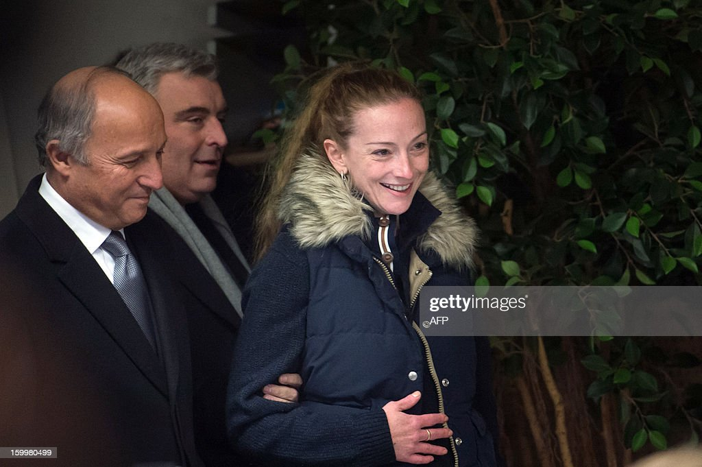 France's Florence Cassez, flanked by French Minister of Foreign Affairs Laurent Fabius (L) and French Junior Minister for Transports and Maritime Economy Frederic Cuvillier, arrives at a press conference at Roissy airport on January 24, 2013 in Roissy-en-France where she landed after being freed from a Mexican prison the day before following a Supreme Court ruling that police violated her rights by staging her arrest for kidnapping on national television seven years ago. After facing 60 years in jail, Cassez, 38, took a flight to Paris, hours after three of five justices voted for her immediate release in a case that had strained Franco-Mexican ties. AFP PHOTO / BERTRAND LANGLOIS