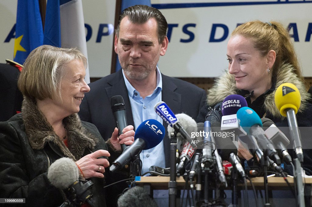 France's Florence Cassez (R), flanked by her lawyer Frank Berton and her mother Charlotte, delivers a speech during a press conference at Roissy airport on January 24, 2013 in Roissy-en-France where she landed after being freed from a Mexican prison the day before following a Supreme Court ruling that police violated her rights by staging her arrest for kidnapping on national television seven years ago. After facing 60 years in jail, Cassez, 38, took a flight to Paris, hours after three of five justices voted for her immediate release in a case that had strained Franco-Mexican ties.