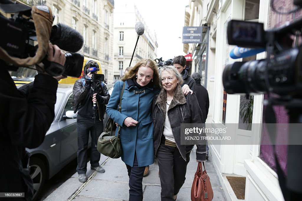 France's Florence Cassez (C), flanked by her mother Charlotte Cassez leaves after a lunch with former French president Nicolas Sarkozy on January 28, 2013 in Paris. Cassez was freed from a Mexican prison four days before, following a Supreme Court ruling that police violated her rights by staging her arrest for kidnapping on national television seven years ago. After facing 60 years in jail, Cassez, 38, took a flight to Paris, hours after three of five justices voted for her immediate release in a case that had strained Franco-Mexican ties. AFP PHOTO / KENZO TRIBOUILLARD