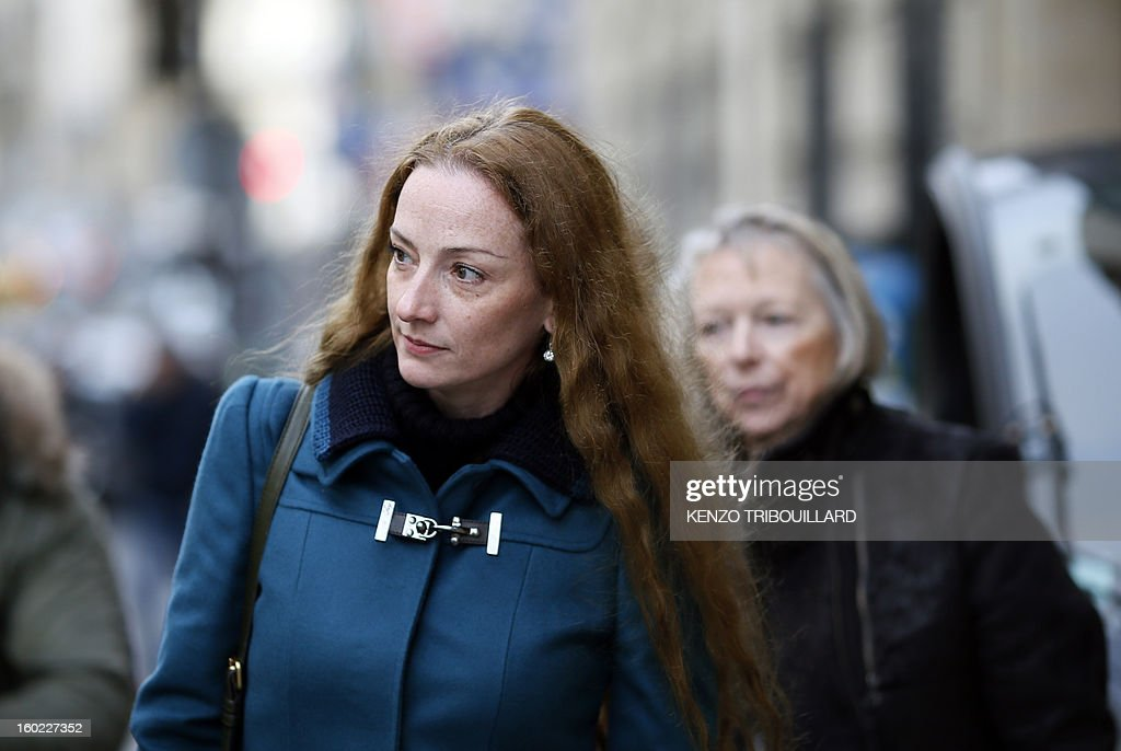 France's Florence Cassez followed by her mother Charlotte Cassez leaves after a lunch with former French president Nicolas Sarkozy on January 28 2013...