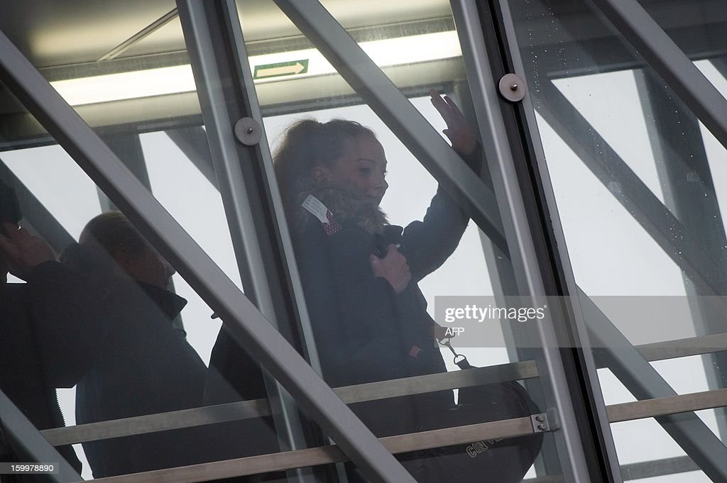 France's Florence Cassez gestures upon her arrival at Roissy airport on January 24, 2013 in Roissy-en-France where she landed after being freed from a Mexican prison the day before following a Supreme Court ruling that police violated her rights by staging her arrest for kidnapping on national television seven years ago. After facing 60 years in jail, Cassez, 38, took a flight to Paris, hours after three of five justices voted for her immediate release in a case that had strained Franco-Mexican ties.