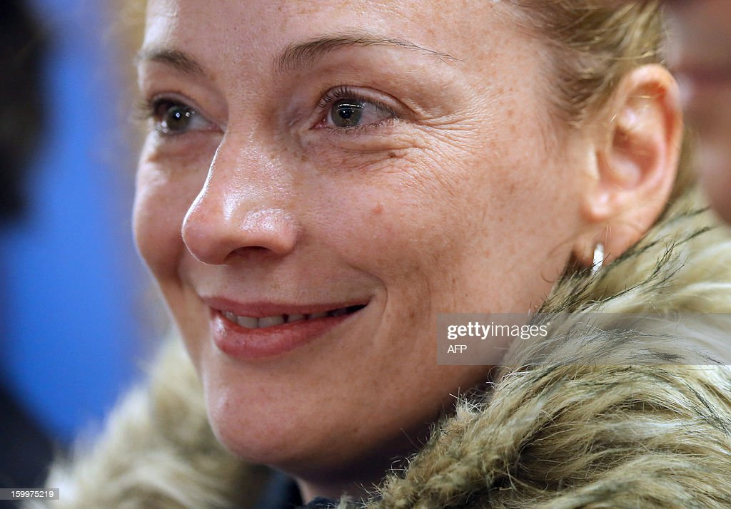 France's Florence Cassez is seen during a press conference upon her arrival at Roissy airport on January 24, 2013 in Roissy-en-France after being freed from a Mexican prison the day before following a Supreme Court ruling that police violated her rights by staging her arrest for kidnapping on national television seven years ago. After facing 60 years in jail, Cassez, 38, took a flight to Paris with her father Bernard, hours after three of five justices voted for her immediate release in a case that had strained Franco-Mexican ties.