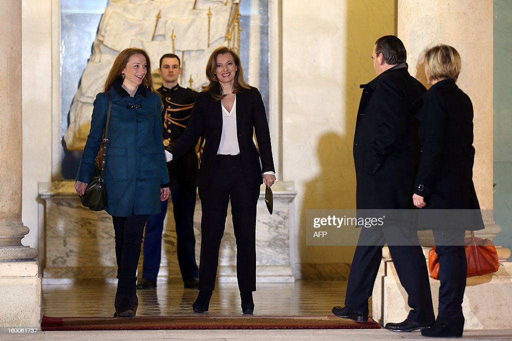 France's Florence Cassez (L) is welcomed by French president Francois Hollande's partner Valerie Trierweiler (C) on January 25, 2013 at the Elysee Palace in Paris. Cassez was freed from a Mexican prison two days before following a Supreme Court ruling that police violated her rights by staging her arrest for kidnapping on national television seven years ago. After facing 60 years in jail, Cassez, 38, took a flight to Paris, hours after three of five justices voted for her immediate release in a case that had strained Franco-Mexican ties.