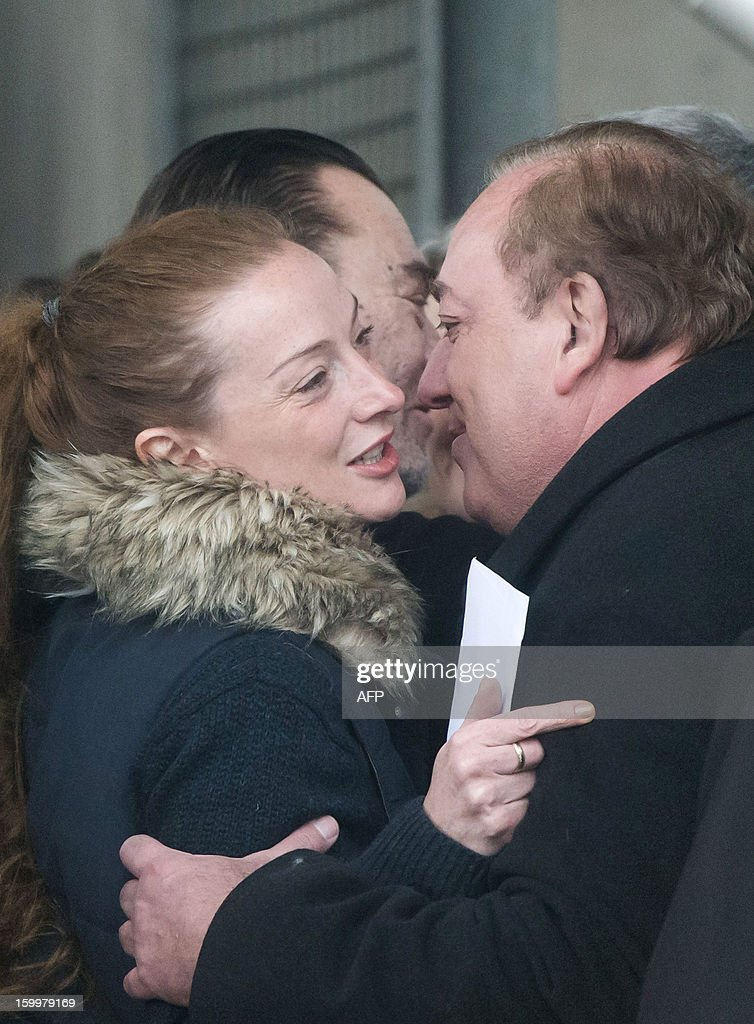 France's Florence Cassez (L) kisses French UMP opposition right-wing party member Marc-Philippe Daubresse (R) next to French minister Laurent Fabius (L) upon her arrival at Roissy airport on January 24, 2013 in Roissy-en-France where she landed after being freed from a Mexican prison the day before following a Supreme Court ruling that police violated her rights by staging her arrest for kidnapping on national television seven years ago. After facing 60 years in jail, Cassez, 38, took a flight to Paris, hours after three of five justices voted for her immediate release in a case that had strained Franco-Mexican ties. AFP PHOTO / BERTRAND LANGLOIS
