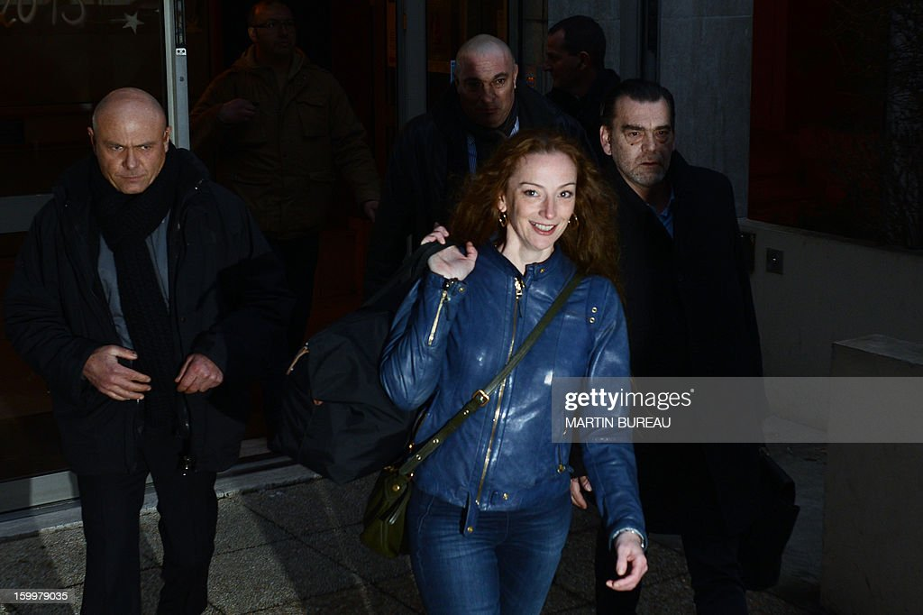 France's Florence Cassez (C) leaves an appartment building shortly after arriving in France on January 24, 2013 in Paris, after being freed from a Mexican prison the day before following a Supreme Court ruling that police violated her rights by staging her arrest for kidnapping on national television seven years ago. After facing 60 years in jail, Cassez, 38, took a flight to Paris with her father Bernard, hours after three of five justices voted for her immediate release in a case that had strained Franco-Mexican ties.