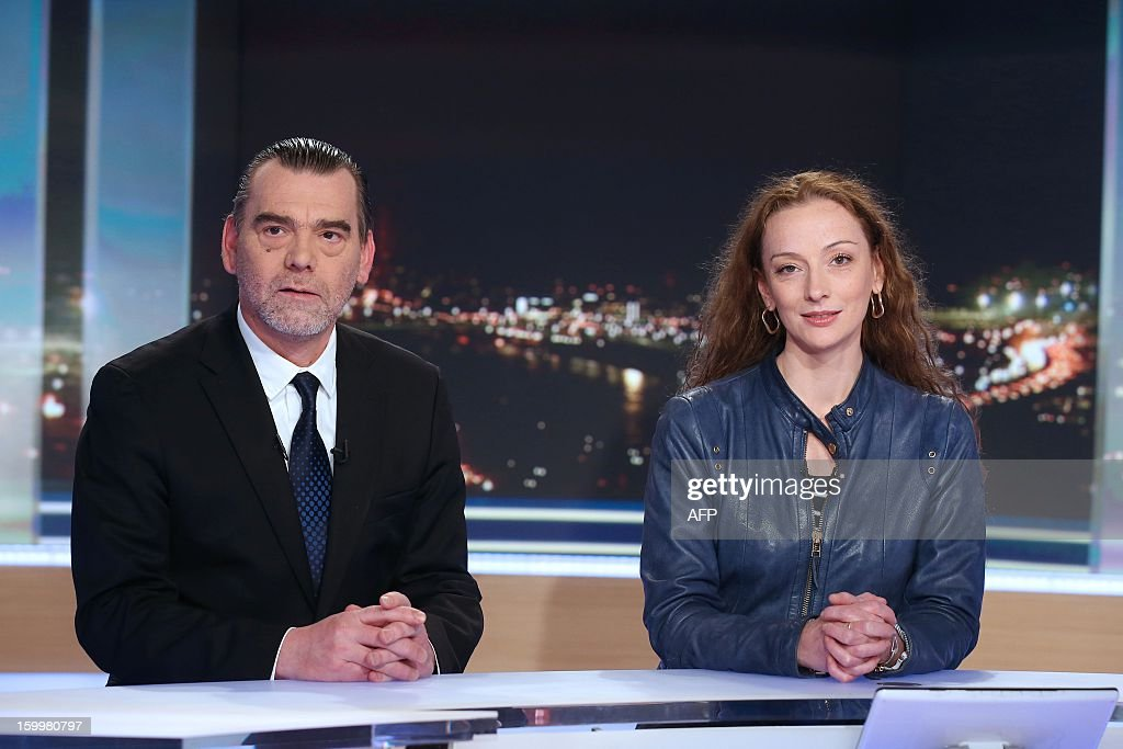 France's Florence Cassez poses with her lawyer Franck Berton (L) prior to take part in the evening news of French TV channel TF1 hosted by French journalist Gilles Bouleau (not pictured) on January 24, 2013 in Boulogne-Billancourt, outside Paris. Cassez landed at the Roissy airport today after being freed from a Mexican prison the day before following a Supreme Court ruling that police violated her rights by staging her arrest for kidnapping on national television seven years ago. After facing 60 years in jail, Cassez, 38, took a flight to Paris, hours after three of five justices voted for her immediate release in a case that had strained Franco-Mexican ties. POOL AFP PHOTO / THOMAS SAMSON