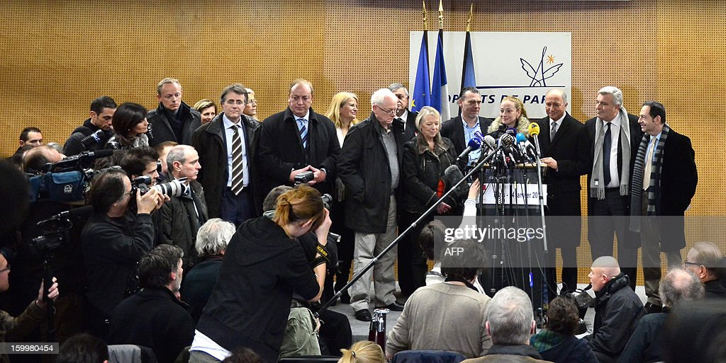 France's Florence Cassez (4thR) speaks next to French Foreign minister Laurent Fabius during a press conference at Roissy airport on January 24, 2013 in Roissy-en-France where she landed after being freed from a Mexican prison the day before following a Supreme Court ruling that police violated her rights by staging her arrest for kidnapping on national television seven years ago. After facing 60 years in jail, Cassez, 38, took a flight to Paris, hours after three of five justices voted for her immediate release in a case that had strained Franco-Mexican ties.