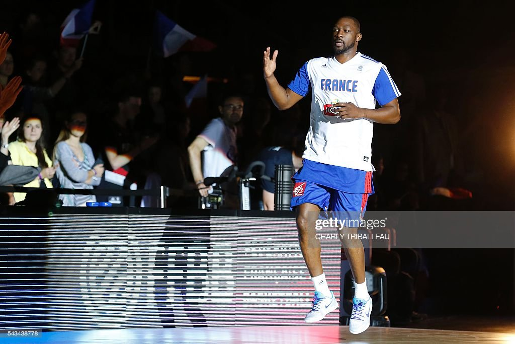 France's Florent Pietrus enters the pitch before the basketball match between France and Japan at the Kindarena hall in Rouen on June 28, 2016. / AFP / CHARLY
