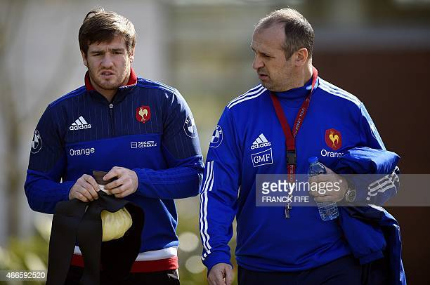 France's fly half Camille Lopez speaks with France's coach Philippe SaintAndre ahead of a training session in Marcoussis south of Paris on March 17...