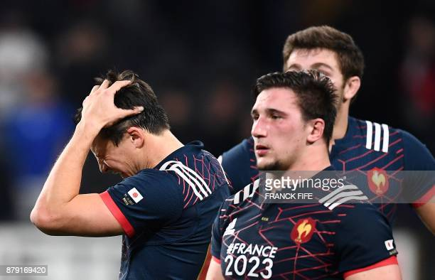 TOPSHOT France's fly half Francois Trinh Duc and France's prop Camille Chat react at the rugby union international test match between France and...