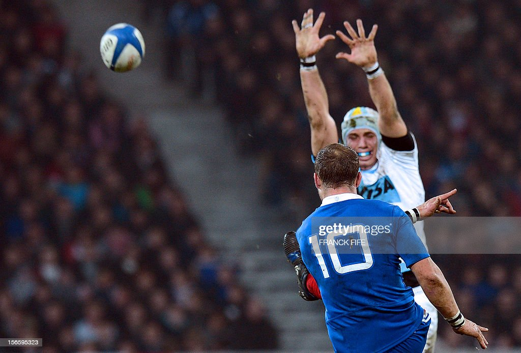 France's fly half Frederic Michalak kicks the ball during the rugby union test match France vs Argentina at the Lille-Grand-Stade on November 17, 2012 in Villeneuve-d'Ascq, northern France. AFP PHOTO / FRANCK FIFE