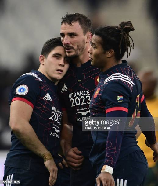 France's flyhalf Anthony Belleau France's wing Teddy Thomas and France's number eight Louis Picamoles react after defeat in the friendly rugby union...