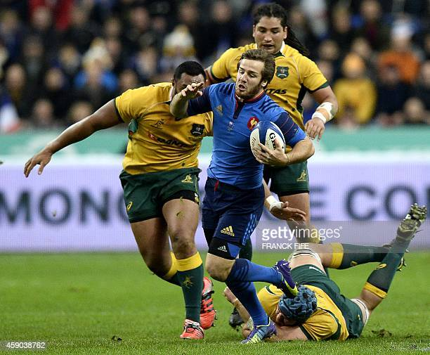 France's flyhalf Camille Lopez evades a tackle from Australia's lock James Horwill during the international rugby union Test match France vs...